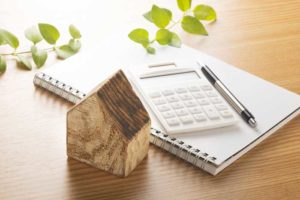 Wooden Home with Calculator